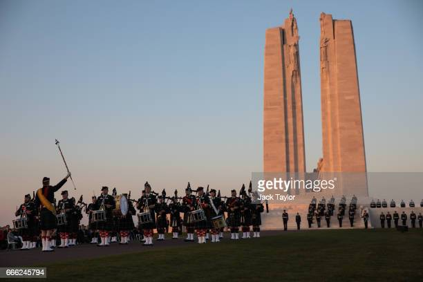 A military band plays as members of the Canadian armed forces take part in a Sunset Ceremony at the Canadian National Vimy Memorial on April 8 2017...