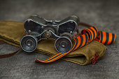 Military binoculars, soldier field cap, George Ribbon. Still life for the Victory Day - may 9