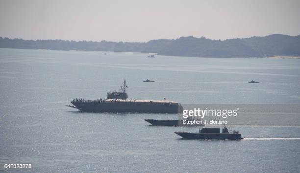SATTAHIP CHONBURI THAILAND Military boats approach the beach head during the ongoing USThai joint military exercise titled 'Cobra Gold' on Hat Yao...