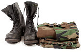 military boots and army soldier uniforms clothing, shoes with camouflage clothes on white background
