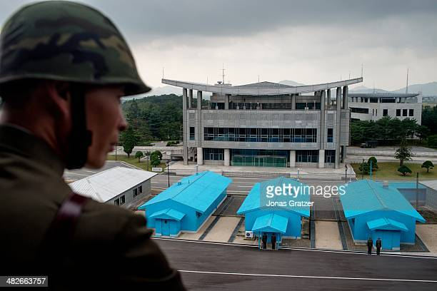 A military border patrol scout works to secure the North and South Korean borders and looks over a military base near the North and South Korean...