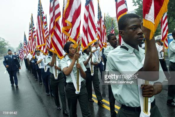 Military cadets march with flags in the Memorial Day Parade on Independence Avenue May 31 2004 in Washington DC Many World War II veterans marched in...
