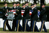 A military casket team carries the casket of US Army CW2 Bruce E Price during a funeral service at Arlington Cemetary May 25 2004 in Arlington...