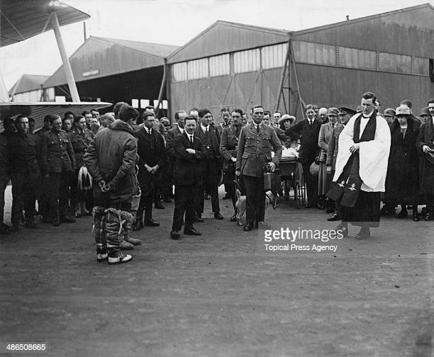 A military chaplain leads prayers at Eastchurch airfield on the Isle of Sheppey in Kent before pilot Major J C P Wood and navigator C C Wylie's...