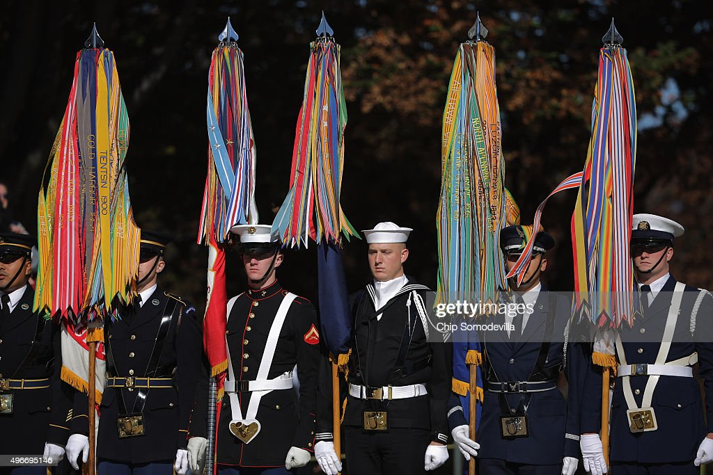 S military color guard members participate in a full honor wreathlaying ceremony at the Tomb of the Unknown Soldier at Arlington National Cemetery to...