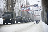 A military convoy of about 30 trucks without license plates moves on November 30 2014 on an avenue in the eastern city of Donetsk controlled by...