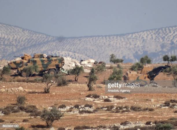Military convoys which departed from the Reyhanli district in Turkey's southern Hatay province are seen in northern Idlib Syria on October 13 2017...