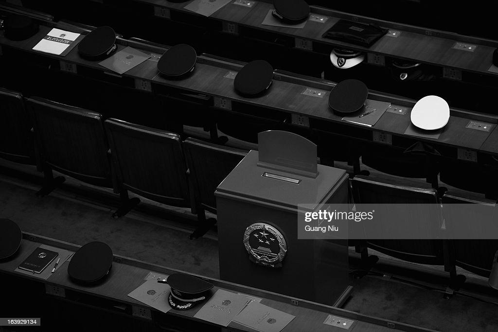 Military delegaters leave their caps on seats to take a break after casting their votes during the sixth plenary meeting of the National People's Congress (NPC) at the Great Hall of the People on March 16, 2013 in Beijing, China. Known as 'liang hui,' or 'two organizations', it consists of meetings between China's legislature, the National People's Congress (NPC), its advisory auxiliary and the Chinese People's Political Consultative Conference.