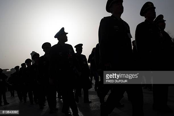 Military delegates arrive at the Great Hall of the People during the opening ceremony of the National People's Congress in Beijing on March 5 2016...