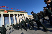 Military delegates arrive for the closing ceremony of the Chinese National People's Congress at the Great Hall of the People in Beijing on March 13...