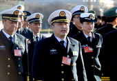 Military delegates arrive for the opening session of the 12th National People's Congress at the Great Hall of the People in Beijing on March 5 2014...