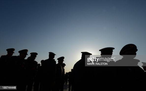Military delegates arrive for the opening session of the Chinese Communist Party's fiveyearly Congress at the Great Hall of the People in Beijing on...