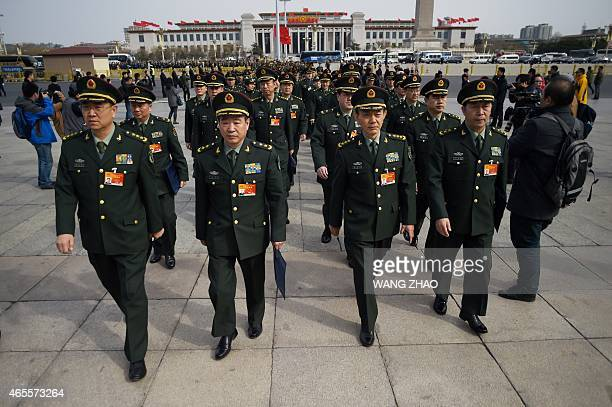 Military delegates arrive for the third session of the 12th National People's Congress outside the Great Hall of the People in Beijing on March 8...
