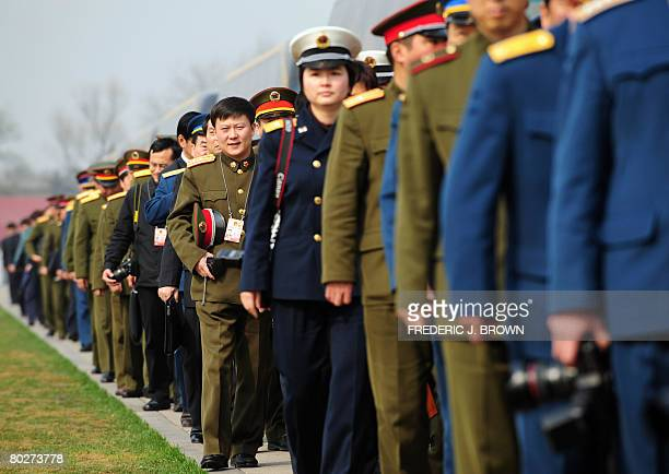 Military delegates arrive on Tiananmen Square for a session of the National People's Congress China's annual rubberstamp parliament on March 17 2008...