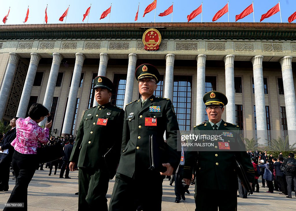 Military delegates leave the opening session of the Chinese Communist Party's fiveyearly Congress at the Great Hall of the People in Beijing on...