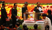 Military delegates of the 11th National Congress of Vietnam Communist Party line up to cast their ballots to elect the VCP's new Central Committee...