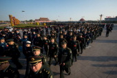 Military delegates walk on Tiananmen Square as they arrive at the opening session of the Chinese Communist Party's fiveyearly Congress at the Great...