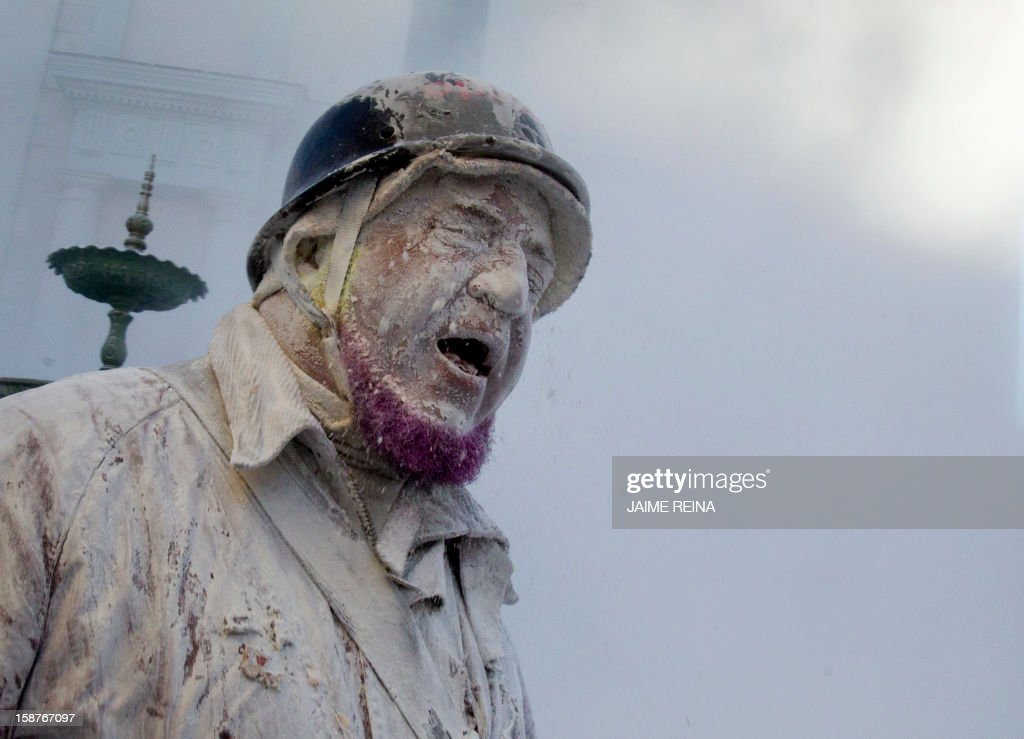 A military dressed man takes part in the battle of 'Enfarinats', a floor fight in the town of Ibi, in the south-eastern Spain on December 28, 2012. For 200 years Ibi's citizens annually celebrate with a battle using flour, eggs and firecrackers outside the city townhall.