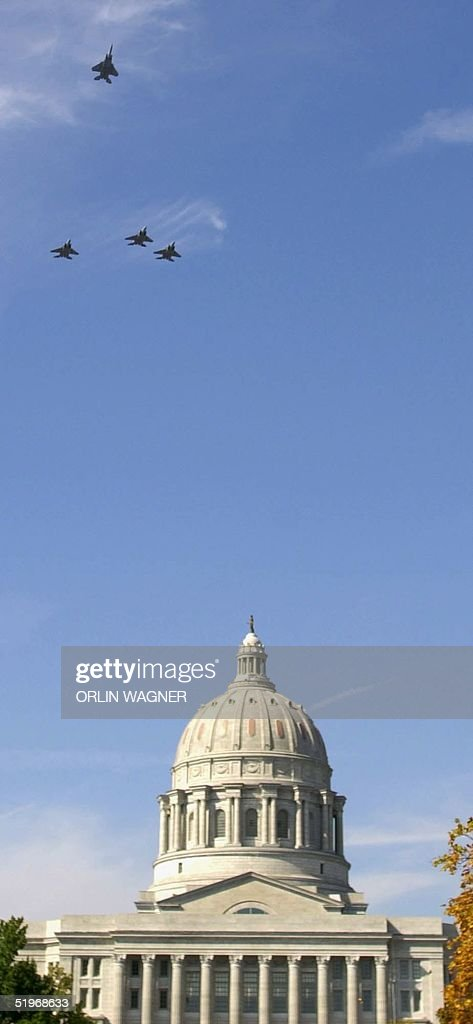 Military F15's flyover the state capitol building in honor of Missouri Governor Mel Carnahan following a memorial service 20 October in Jefferson...