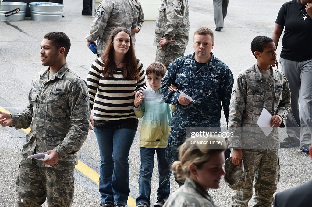 A military family attends the 75th Anniversary USO Show on May 5 2016 at Joint Base Andrews in Camp Springs Maryland