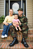 Military family sitting on front stoop