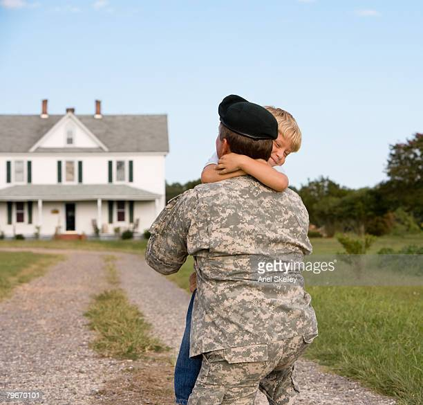 Military father hugging son
