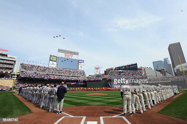 A military fly over of F16 jets pass over the stadium as the Minnesota Twins and the Boston Red Sox line up prior to the Opening Day game between the...