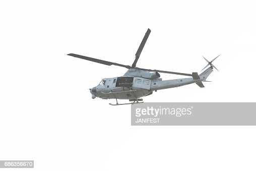 Military Fully Armed Helicopter Flying In The Sky Stock