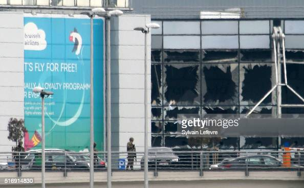 Military guard the area as passengers are evacuated from Zaventem Bruxelles International Airport after a terrorist attack on March 22 2016 in...