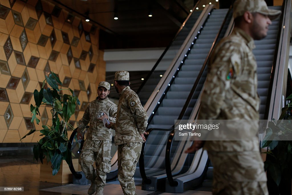 Military guards keep watch in the lobby of the Libyan General National Congress in Tripol Libya on March 10 2015 The seat of power in western Libya...
