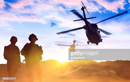 Military Helicopter and Army Soldiers at sunset