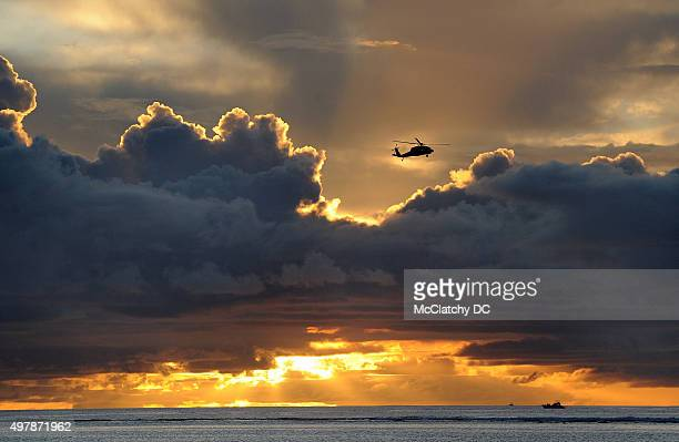 A military helicopter flies over the waters of Agana Bay in Hagatna Guam on Aug 10 2015 Residents can expect to see more military aircraft in the...