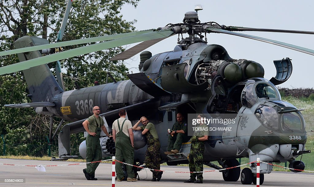 A military helicopter is on display at the International Aerospace Exhibition (ILA) in Schoenefeld on May 30, 2016. The Aerospace Exhibition at Schoenefeld Airport takes place from June 1 to 4, 2016. / AFP / TOBIAS