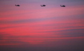 S military helicopters fly above the city at dusk on November 30 2011 in Baghdad Iraq Iraq is transitioning as the US military continues its...
