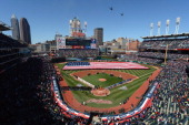Military helicopters fly over Progressive Field during the national anthem prior to the opening day game between the Cleveland Indians and the...
