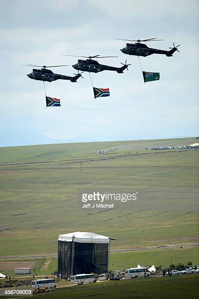 Military helicopters fly over the burial site where former South African President Nelson Mandela was buried on his family's property in his...