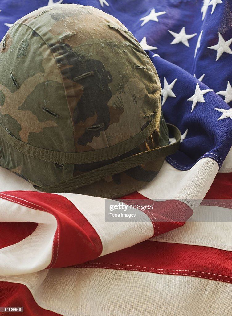 Military helmet on American flag