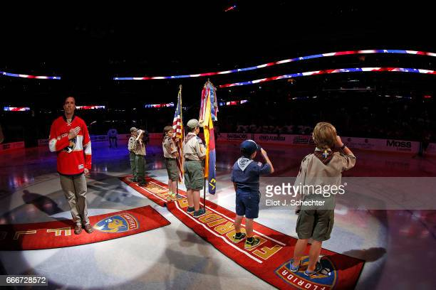 Military Hero US Army Major Jim Hillabrandt stands at attention on the ice for the national anthem prior to the Florida Panthers hosting the Buffalo...