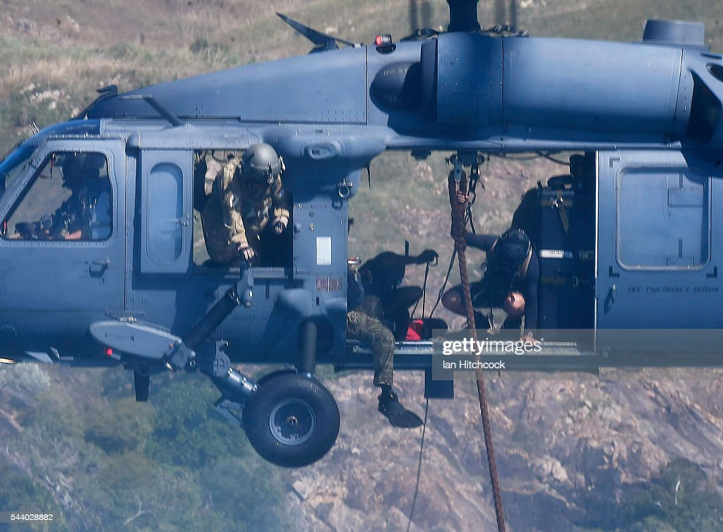 S military HH-60 Pave Hawk Helicopter is seen deploying rescue eqiupment over a simulated crash site during Exercise Angel Reign on July 1, 2016 in Townsville, Australia. Exercise Angel Reign is the largest Air Force led field exercise in Australia this year and is a bilateral Joint Personnel Recovery exercise which aims to practice search and rescue activities both at sea and on land.