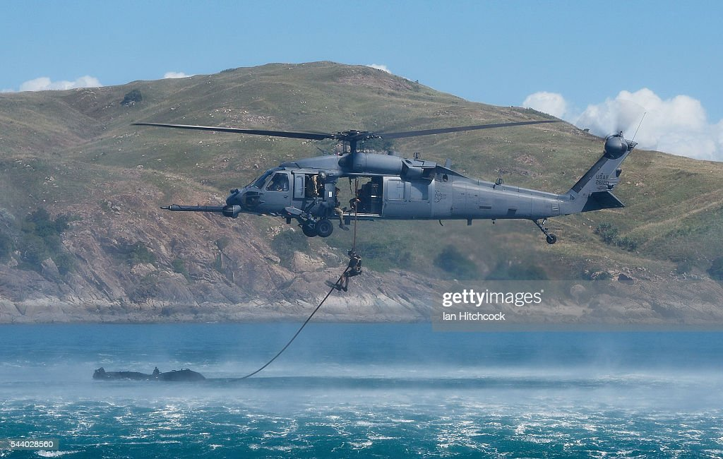 S military HH-60 Pave Hawk Helicopter is seen dropping a rescue crewman into the ocean over a simulated crash site during Exercise Angel Reign on July 1, 2016 in Townsville, Australia. Exercise Angel Reign is the largest Air Force led field exercise in Australia this year and is a bilateral Joint Personnel Recovery exercise which aims to practice search and rescue activities both at sea and on land.