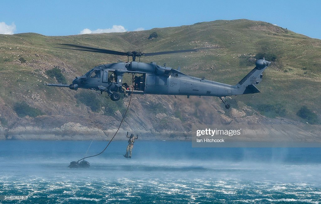 S military HH-60 Pave Hawk Helicopter is seen dropping a rescue crewmaninto the ocean over a simulated crash site during Exercise Angel Reign on July 1, 2016 in Townsville, Australia. Exercise Angel Reign is the largest Air Force led field exercise in Australia this year and is a bilateral Joint Personnel Recovery exercise which aims to practice search and rescue activities both at sea and on land.