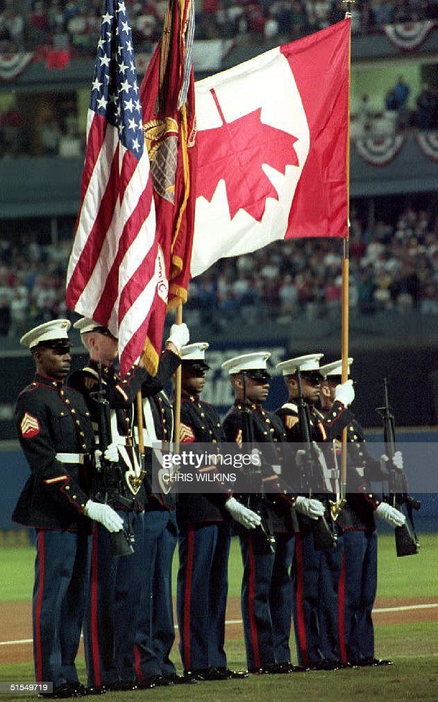 S. military honor guard displays the Canadian flag upside down during the playing of the national anthems 18 October, 1992 at the start of game two of the World Series in Atlanta, GA. The Toronto Blue Jays won game two over the Atlanta Braves 5-4 to even the series at one game apiece.