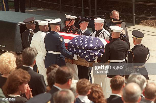 Military Honor Guard loads a flagdraped casket bearing the remains of the Vietnam War unknown into a hearse during ceremonies 14 May at the Tomb of...
