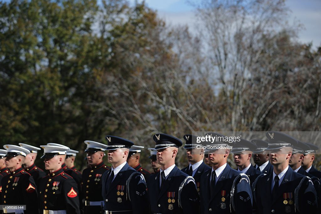 S military honor guard members participate in a full honor wreathlaying ceremony at the Tomb of the Unknown Soldier at Arlington National Cemetery to...