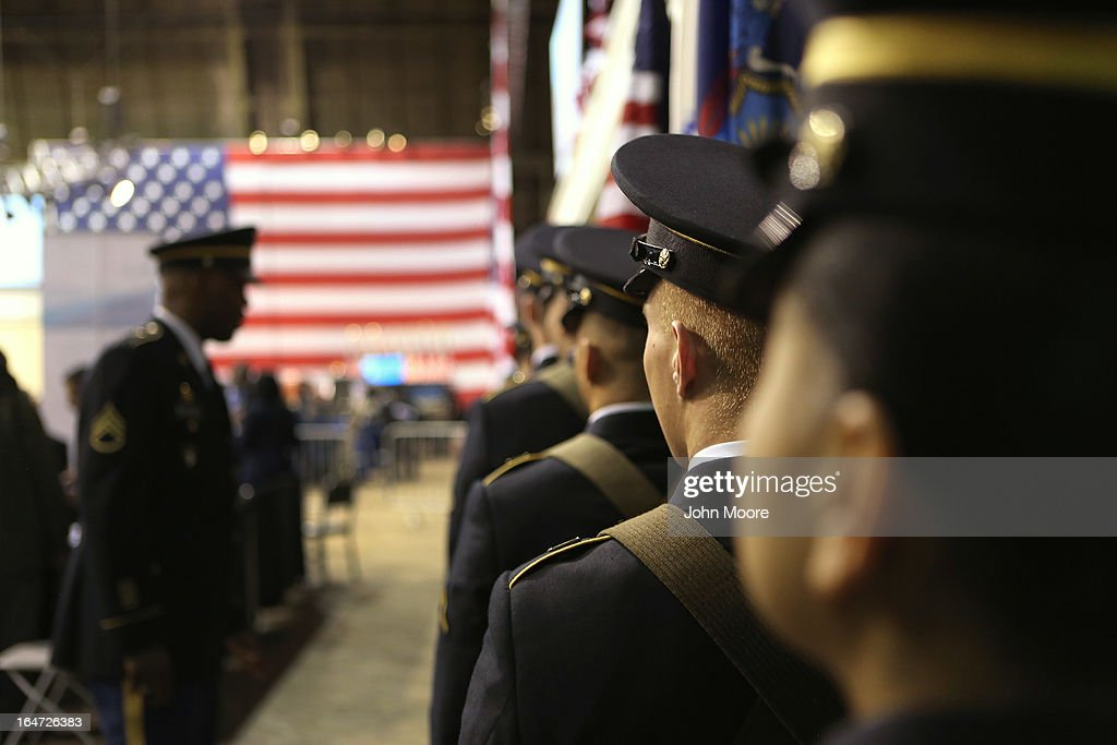 A military honor guard prepares to present the colors at the Hiring Our Heroes job fair held on March 27, 2013 in New York City. Hundreds of U.S. military veterans and their spouses turned out to meet more than 100 employers participating at the second annual event, hosted by the U.S. Chamber of Commerce National Chamber Foundation. Lead sponsors were Capital One Financial Corporation and Toyota.