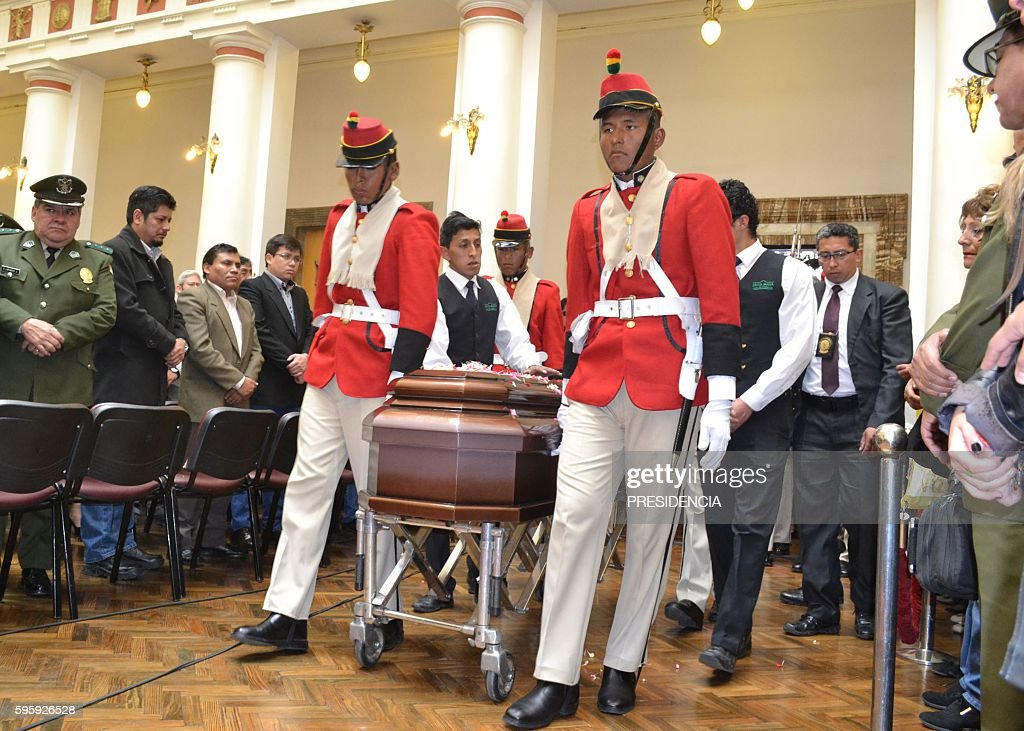 Military honor guards carries the coffin of deputy interior minister Rodolfo Illanes during his wake at the presidential Quemado Palace in La Paz on...