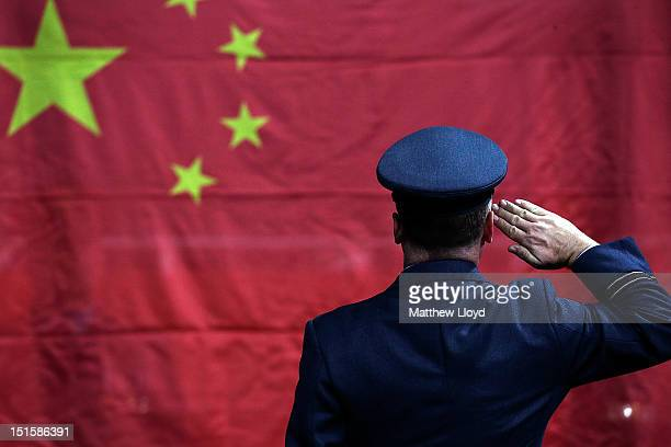 A military honour guard raises the flag of China during a table tennis medal ceremony on day 10 of the London 2012 Paralympic Games at ExCel on...