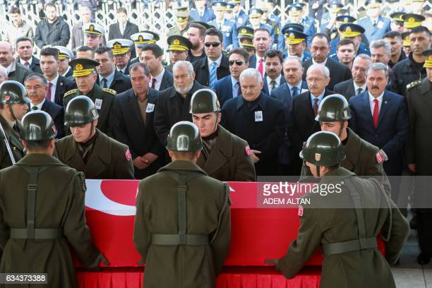 TOPSHOT Military honour guards carry the coffin of Mahmut Uslu one of five Turkish soldiers killed on Ferbuary 7 in an attack by IS militants around...