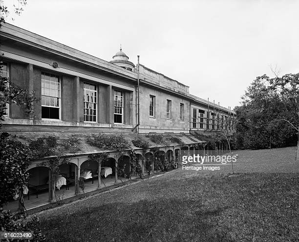 Military hospital at Woburn Abbey Bedfordshire July 1915 Exterior of the military hospital at Woburn Abbey showing beds on a veranda and wounded...
