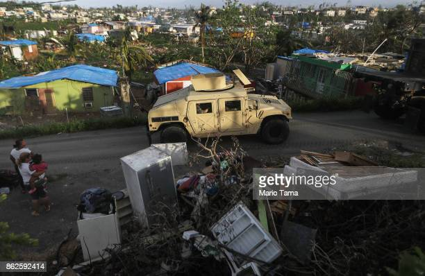 S military Humvee departs after soldiers unloaded food and water provided by FEMA to residents in a neighborhood without grid electricity or running...